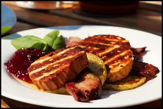 Polish cult recipes - here grilled oscypek (sheep's cheese) with bacon, grilled apple and cranberry sauce