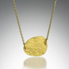 """A 24k and 18k yellow gold """"Melissa"""" necklace with a single element. Chain measures 16""""."""