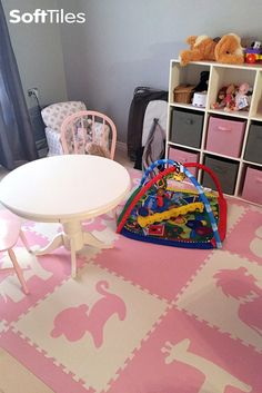 A cute girl's playroom floor using SoftTiles Safari Animals in light pink and white. This 9 piece play mat set covers 6.5' x 6.5' and includes our special sloped borders.