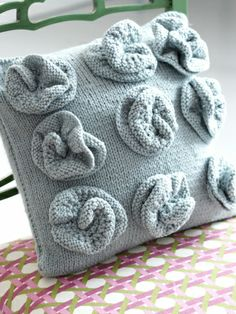Rosette Cushion | Yarn | Free Knitting Patterns | Crochet Patterns | Yarnspirations