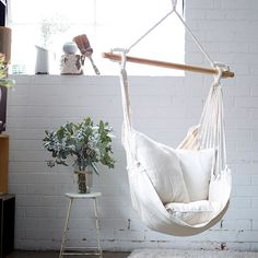 Enjoy a perfect lazy afternoon under your favourite tree, on the verandah or in your courtyard in the Noosa Hammock Chair Swing. Made with a heavy duty weave, sit back and relax.  The Collective Sol Noosa also comes with two luxurious cushions for even more comfort.  - Natural colour - Includes Hammock with Wooden spreader bar + 2 comfy cushions - An easy hang, with an S hook (not included), onto the O rings - 150cm x 90cm  Cushions 45cm x 45cm  120kg weight - Heavy weave polycotton