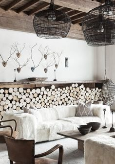 love the basket lighting and the log storage. great room
