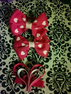 Itty Bitty Chik Fashions Link to Vendor Page www.facebook.com/ittybittychikfashions Brief Description of the Item :Heart hair tie set with a heart clippie  Starting Bid : $3 Bid Increment Amount : $1 Shipping Fee $2.50  **a winning bid over $7 will be upgraded to a PAIR of heart clippies