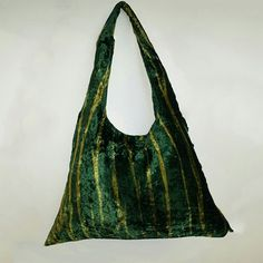 GREEN TIGER HOBO: Deep green velvet hobo, with stripes and a sequence flower embellishment which is removable. Can be used as a broach. #Clutches #Satchel  #HandBag #purse #Clutchonline #LeatherBags #Gifts  #GiftsIdeas #Shoulderbag  #handbags #handbagseller #hobobag #Hobos #CrossBody #Handbags #LeatherWallets #WomensFashions #embroidery #bags