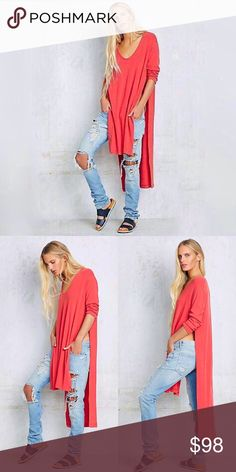 Free People Nantucket Drippy Tunic You'll want to live in this seriously. Super soft & stretchy tunic tee with a high low hem and exaggerated side vents. Low scoop neck and three quarter sleeves. Nantucket Red. NWT. Free People Tops Tunics
