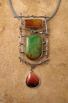 Pendant | Patricia Reinking.  Sterling silver, fossil coral and Nevada chrysocolla.