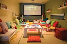 Floating shelves, books, desk, chairs, sofas, media from a projector screen, pillows, rugs, toys.