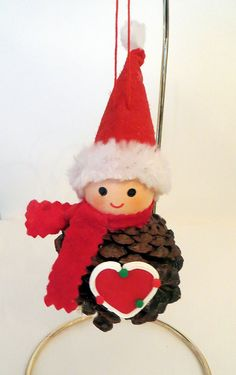 Pinecone Elf Ornament with Heart by EllensClayCreations on Etsy, $9.95
