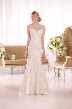 We love this fishtail wedding dress – it has a warm colour palette that will suit all skin tones and a beautiful lace pattern on the fabric.