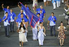Guam's flag bearer Maria Mcqueen Dunn holds the national flag as he leads the contingent in the athletes parade during the opening ceremony of the London 2012 Olympic Games at the Olympic Stadium July 27, 2012.