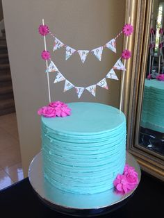 Beautiful birthday cake with pastel bunting