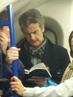 Reading his book on the Tube!