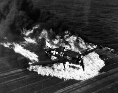 Ensign Ardon R. Ives of Fighting-Bombing Squadron VBF-9 crashed his F6F-5 Hellcat through the barrier on USS Lexington (Essex-class) and ruptured the center-line fuel tank February 1945 western Pacific.