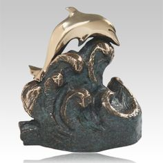 The Tranquility Bronze Cremation Urn is made by the lost wax cast bronze method with a striking patina that suggests the deep color of the sea. The dolphin is polished to a brilliant finish.