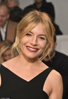 Stunning: Sienna wore her blonde locks in a tousled blonde locks in a messy up do as she p...