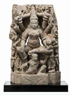 A BIEGE SANDSTONE STELE REPRESENTING A SEATED VAISHNAVI, CENTRAL INDIAN, 12TH CENTURY