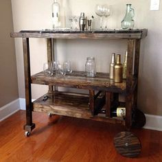 This is a custom built bar cart with removable bottom tray and six bottle wine rack. I can do any variation of stain and gloss. These bar