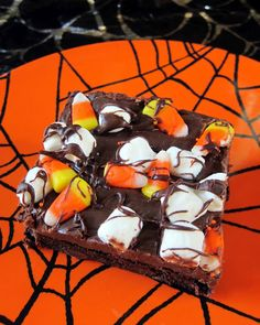 Haunted Road Brownies: 1 box brownie mix, plus ingredients to make 9x13-inch pan, 1 can sweetened condensed milk, 2 cups chocolate chips, 1 cup mini marshmallows, 1/2 cup candy corn, 1/3 cup chocolate chips