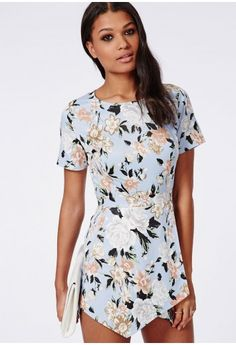 Get your dose of floral magic with this satin feel playsuit. In a tailored style with skort design and stunning floral print, this chic playsuit will lift your look in an instant. Wear this feminine print with powder pink heels and a matchi...