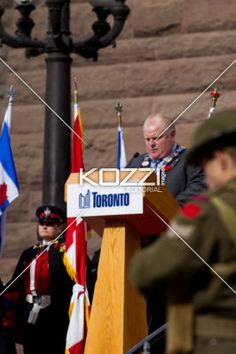 view of a senior man giving speech at podium. - View of a government leader giving speech at podium.