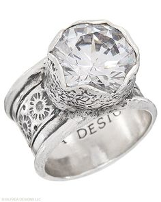 Bring on the bling with this wide-band Sterling Silver and Cubic Zirconia Ring. Whole sizes 5-11.
