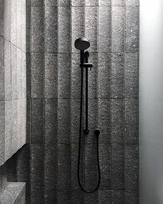 Inspired by tiles in Japan, B.E Architecture's custom curved granite tiles have been developed to create variation across the surface of the walling in the bathrooms we are designing for our projects.