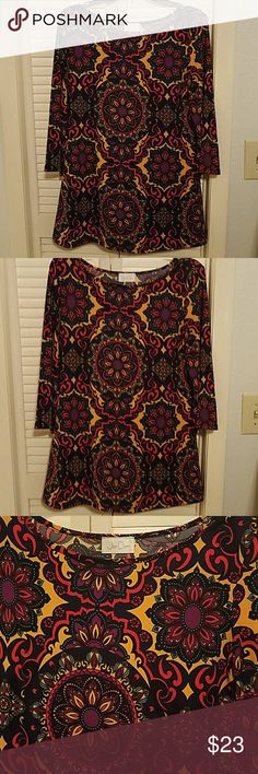 Festive  adorable top Very colorful top.  Goes with yellow...red...black...turqoise leggings or slacks.  3/4 sleeve.   Many compliments Jon Den Tops Tunics