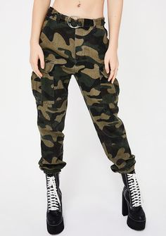 Ready For Combat Camo Pants cuz you never back down. These green camo pants have a loose comfy fit and a zipper N' button front closure with a silver o-ring detail.