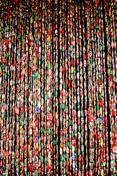 """photographer said """"A bar ... in a remote part of the interior of Dominica had this 'beaded'  curtain made out of beer bottle caps."""""""