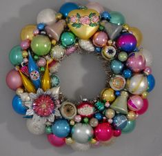 Here is a stunning Holiday Wreath made with vintage glass ornaments in pinks, blues, golds, greens and whites. This beautiful, one-of-a-kind wreath