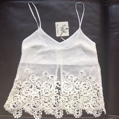 ❌FLASH SALE-10pm Angel Biba Boho White Tank Top NWT Adorable, fun and flirty white tank top. Perfect for concerts, festivals or that beach vacation. Eyelet. Bust area is lined and the rest is open, gives is a conservative crop top look with a little coverage! Adjustable straps and zipper back over lining. Size 8. BRAND NEW! MAKE ME AN OFFER!  I do bundles of 15% off for 3+ items. Most things NWT or only worn once!! I love offers!  Angel Biba Tops Tank Tops