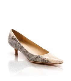 Lower heel for comfort yet super cute pointed toe and snake skin.