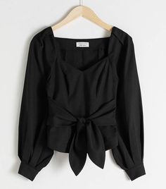 Long sleeve blouse with a defined waist, tie up detail and gathered balloon sleeves. V-neck Length of blouse: / (size Model wears: EU UK US 4 / Small Trendy Fashion, Fashion Outfits, Tapered Jeans, Wrap Blouse, Fashion Story, Black Blouse, Models, Blouse Designs, Shirt Blouses