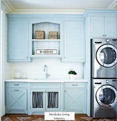 A Muskoka Lake House Laundry Room with Blue Cabinets
