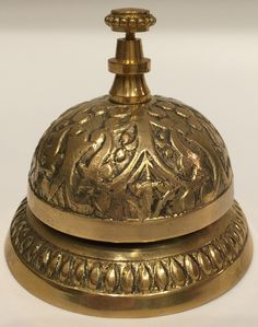 DESCRIPTION Hotel Desk Clerk Bell - Decorative, functional accent for your home, dining table, special event or place of business. - Lovely desk bell that produces an enchanting ring. - Beautifully ca