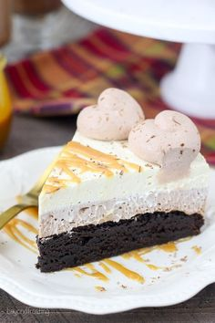 This decadent Caramel Hot Chocolate Brownie Mousse cake is three layers of dessert bliss. There is both a chocolate mousse and a caramel whipped cream.