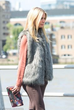 This is hot work! With the hot sun beating down on her, no wonder Gwyneth didn't look too ...