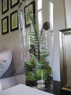 Make a faux terrarium with fake plants! Now that's something I can handle. :)