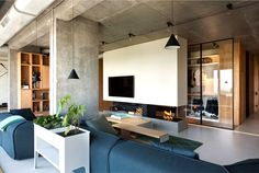 Fresh Green Plants, Copper and Concrete at Apartment Designed by Olga Akulova