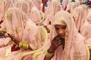 An Indian Muslim bride looks aside during a mass marriage for 47 couples in Ahmadabad, India.  (Photo by Ajit Solanki / AP). First published in the November 04, 2012, 2:14 p.m. edition (http://dailysource.org/pictures/show/42308).