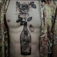 Tattoo by ed taemets #Bottle, #ChestTattoo, #Rose, #TattooIdea