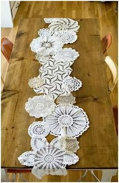 Oh how cute! Doilies sewn together to create a table runner.