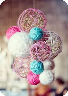 diy baby mobile: take copper wire, roll wire into shape of a ball, make different sizes. Take several colors of yarn and wrap the balls with them. Connect with together with small peices of wire and attach a string and hang!!