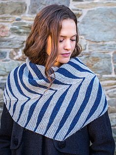 Mrs. Watson is a garter stitch scarf with a genius design, using a series of short rows and strategic increases to create feather-like stripes.