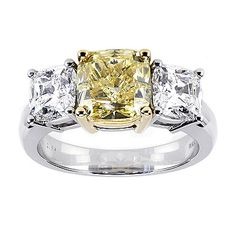 Birks Fancy Diamond Engagement Ring Collection, 3-stone Fancy Intense Yellow Diamond Engagement Ring, in platinum.  I'll take a yellow stone anyday! :)