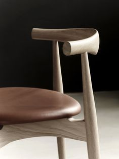 CH20 Elbow Chair - Carl Hansen & Søn, a wood stackable chair is rare, and this one is beautiful