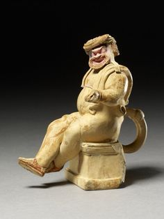 Terracotta flask in the form of a comic actor seated on an altar, perhaps Priam at the sack of Troy.