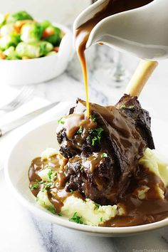 Braised Herb Lamb Shanks produce succulent, fall-off-the-bone tender meat that is bursting with flavor from herbs, wine and a rich, silky sauce.