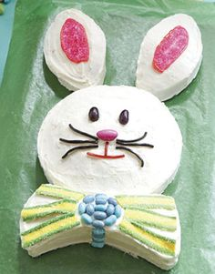 cute Easter Bunny cake (with jelly beans, jordan almonds, licorice rope and sprinkles/decorating sugar for the ears and bow tie)    #easter #eastereggs #happyeaster #spring #holidays #happyholidays #springfling #springtime #pastels #easterideas #easterinspiration #planningforeaster www.gmichaelsalon.com Easter Bunny Cupcakes, Cupcake Cakes, Cake Decorating, Cupcakes, Cupcake, Muffins, Cup Cakes