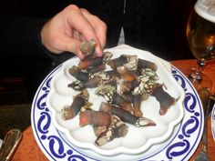 Crustacean - Percebes.iguaria - Plates with barnacles,  in this case goose neck barnacle (Pollicipes pollicipes) served at a Madrid restaurant.
